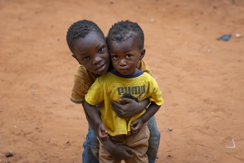 Portrait of two young boys at the Missira neighborhood in the city of Bissau, Guinea Bissau stock photography