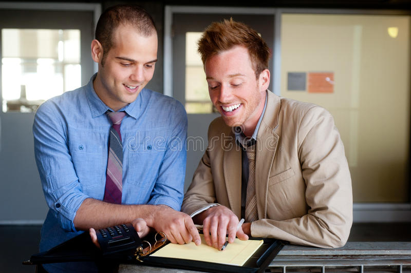 Portrait of two young handsome businessmen stock photography