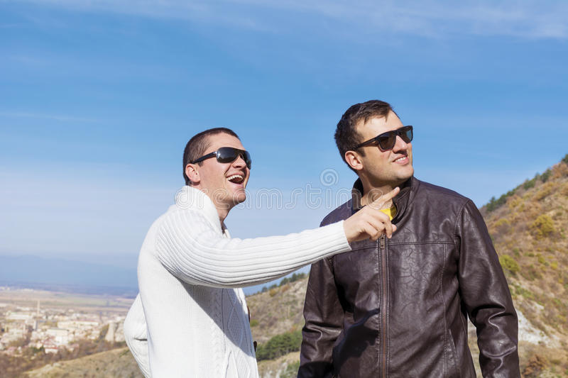 Portrait of two young men talking outdoor royalty free stock images