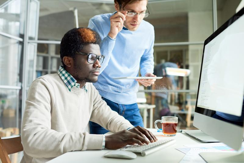 Web Developers Working on Code stock image