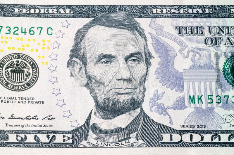 Portrait of U.S. president Abraham Lincoln on United States five-dollar bill macro.  royalty free stock images