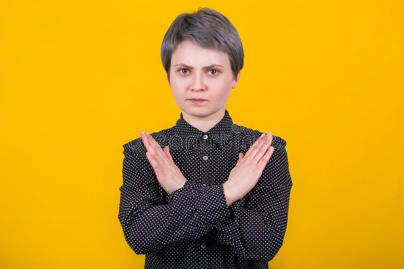 Woman showing prohibition sign stock image