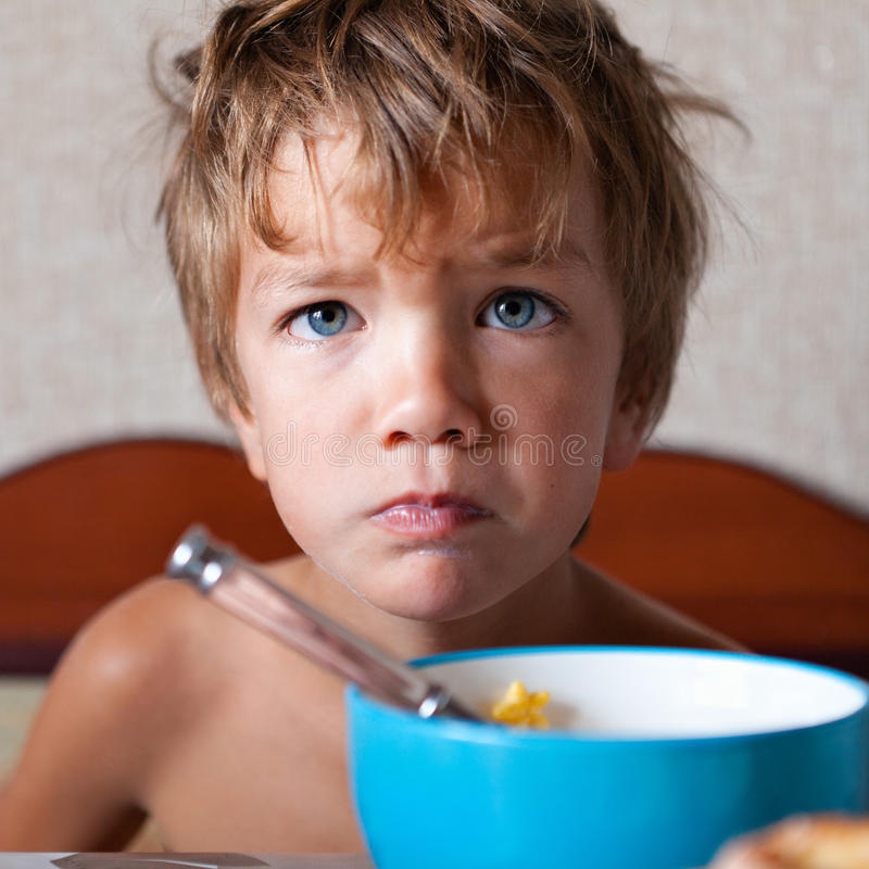 Portrait of unhappy boy, not eating royalty free stock images
