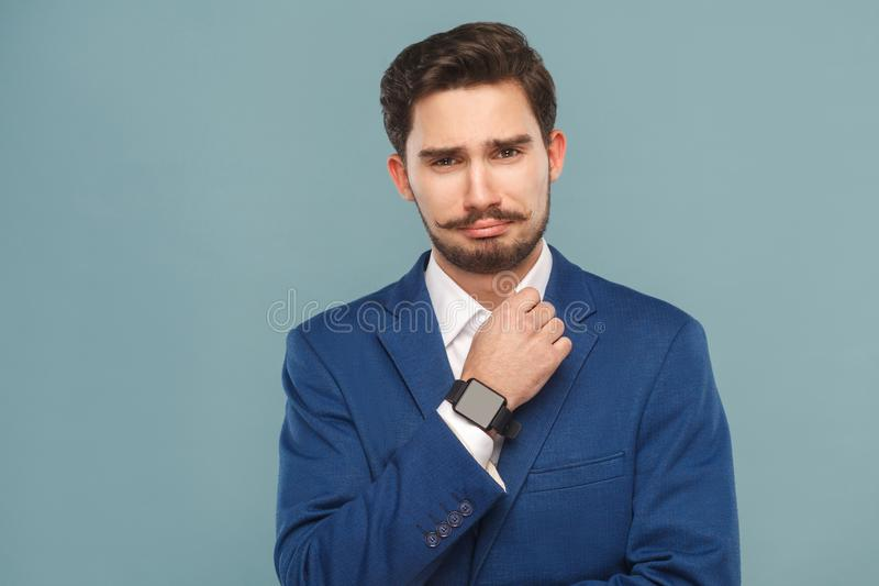 Portrait of unhappy business man wearing classic jaket, smart wa royalty free stock images