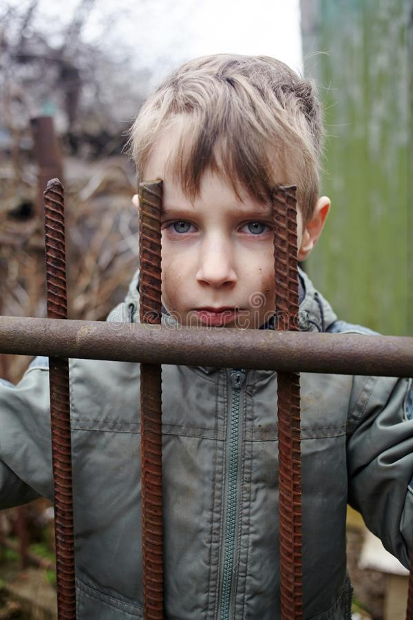 Portrait of an unhappy homeless child in a poor neighborhood.  stock images