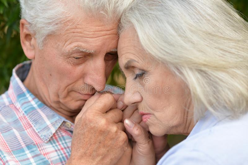 Portrait of unhappy senior couple in the park royalty free stock images
