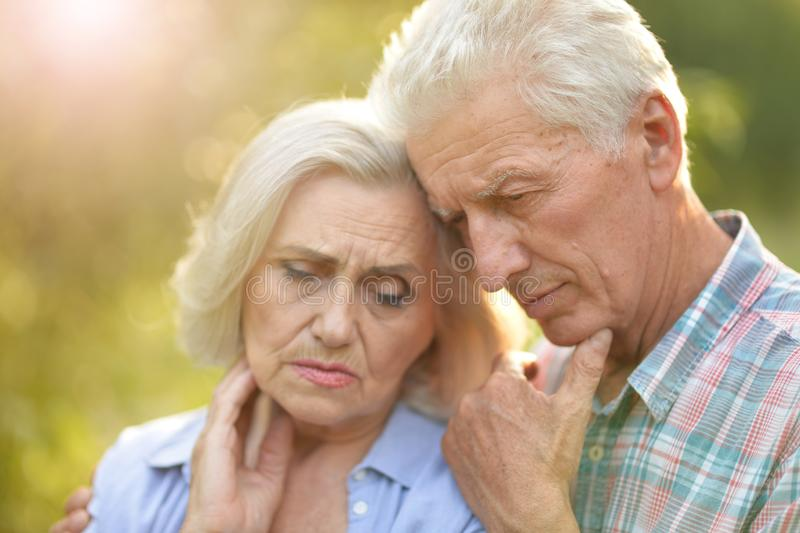 Portrait of unhappy senior couple in the park stock photos
