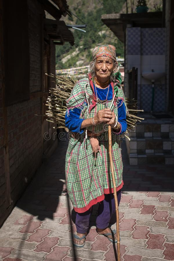 Portrait of an unidentified senior woman in Manikaran village, Parvati valley, Himachal Pradesh state, India. Manikaran, India - June 3, 2017: Portrait of an royalty free stock photo