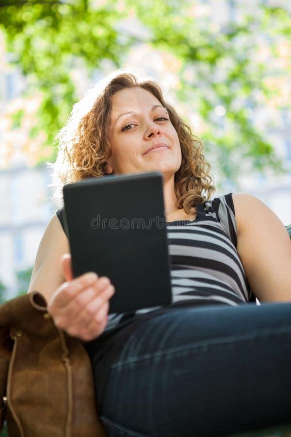 Portrait Of University Student Holding Digital stock photo