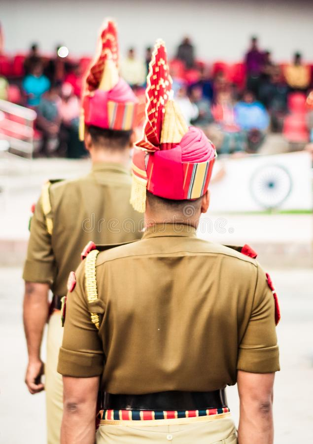 Portrait of an unrecognizable indian policeman standing in a row. Rear view stock photo