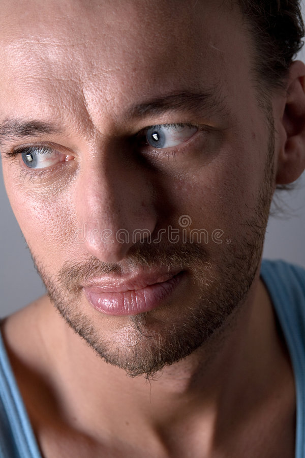 Portrait of a unshaven adult man royalty free stock image