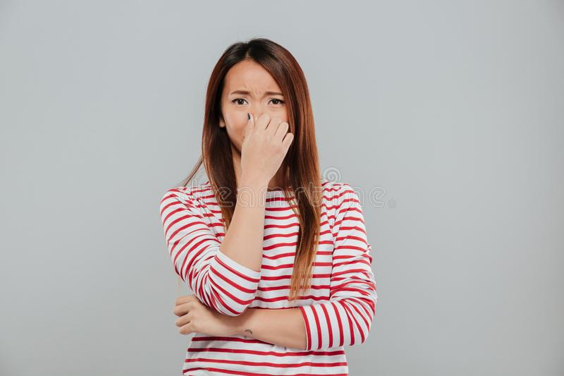 Portrait of a an upset disappointed asian woman crying stock image