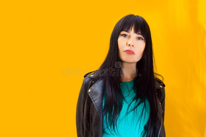 Portrait upset girl woman background yellow sad grief sorrow brunette shadow sun light. Portrait of upset girl with red sunglasses. Sadness woman on yellow stock image