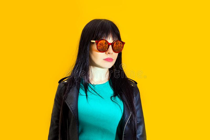Portrait upset girl woman sunglasses background yellow sad grief sorrow brunette shadow sun light tropical leaves. Portrait of upset girl with red sunglasses stock image