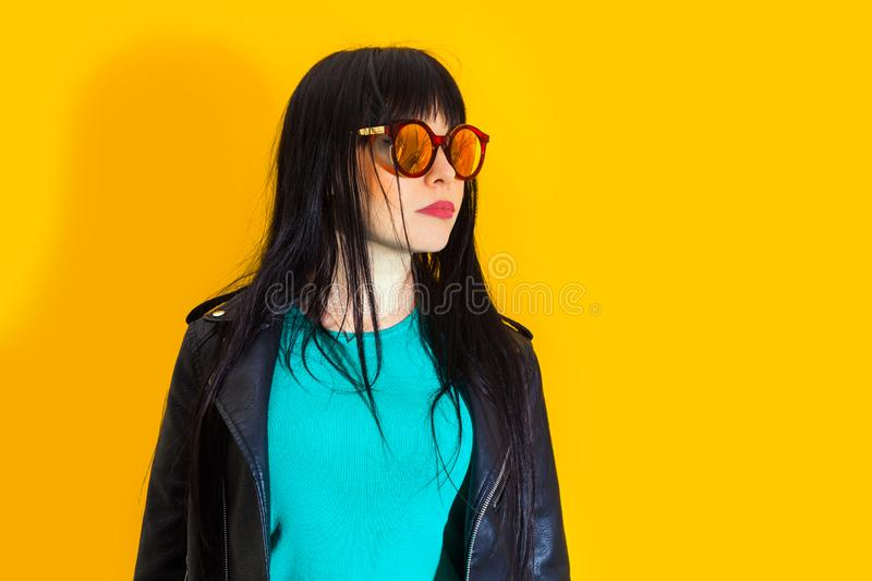 Portrait upset girl woman sunglasses background yellow sad grief sorrow brunette shadow sun light tropical leaves. Portrait of upset girl with red sunglasses royalty free stock photos