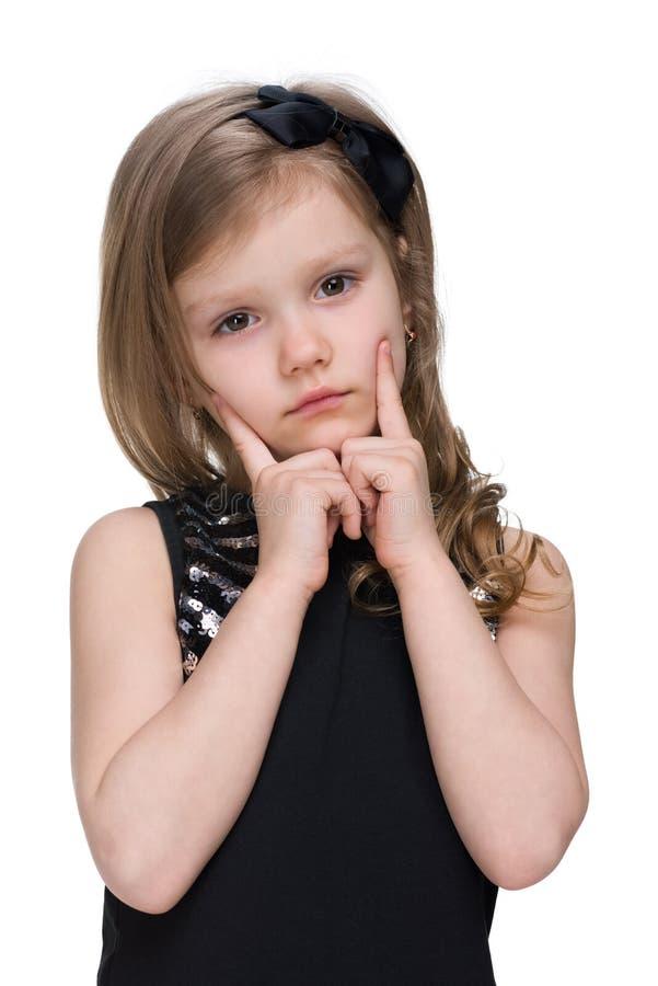 Portrait of an upset little girl stock photo