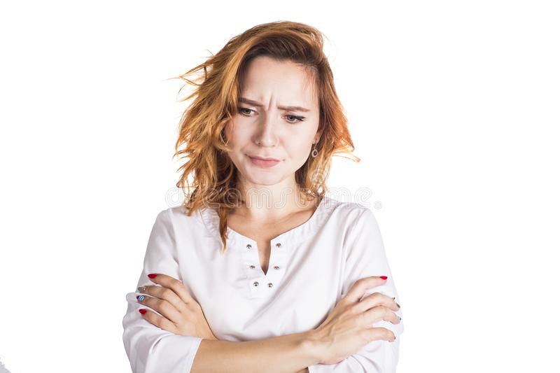 Portrait of an upset young casual brunette woman standing with arms folded isolated over white background royalty free stock photos