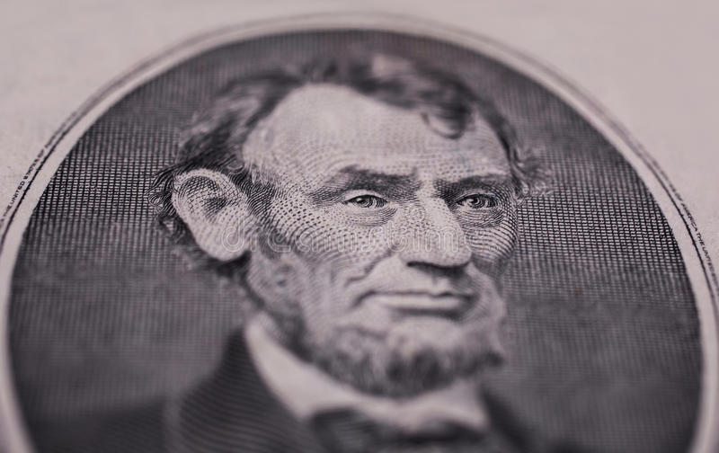 Portrait of US President Abraham Lincoln on the five dollar bill royalty free stock images