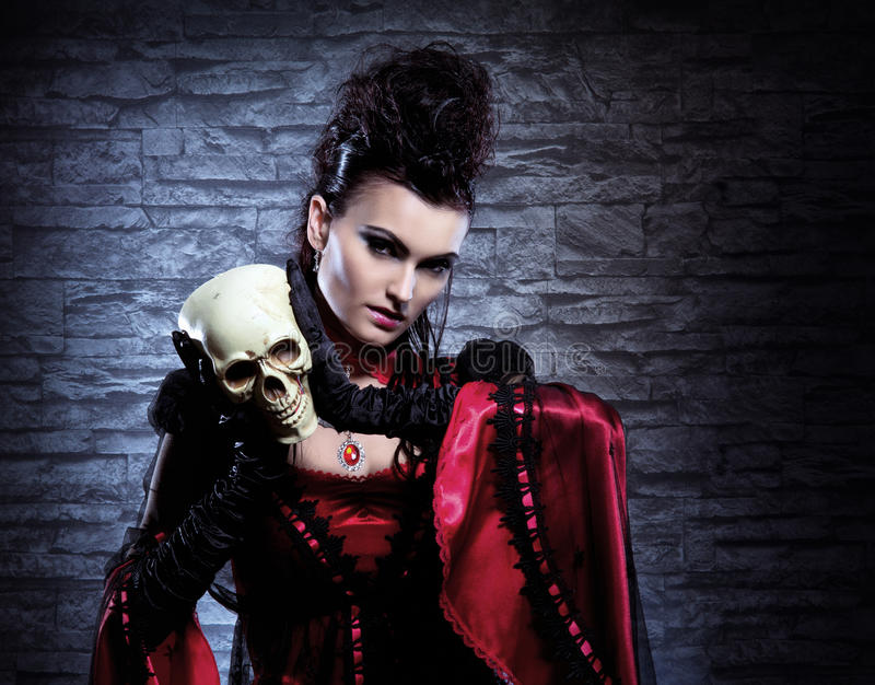 Download Portrait Of A Vampire Lady Holding A Human Skull Stock Image - Image: 27178473