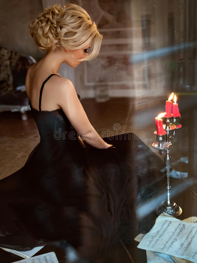 Portrait of a very beautiful sensual girls blonde with smoky ice royalty free stock image
