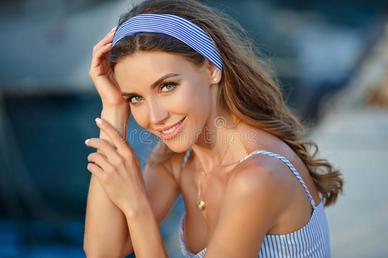 Portrait of a very beautiful sensual and girl in a blue str stock image