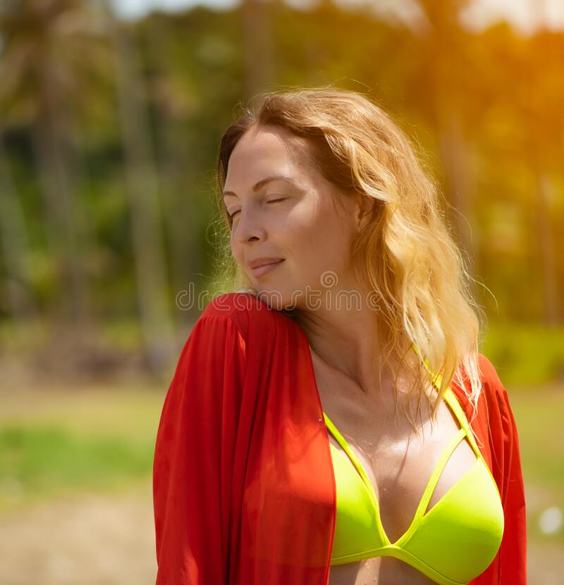 Portrait of Very beautiful slim woman on a wild tropical beach royalty free stock photo