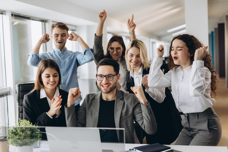 Portrait of very happy successful expressive gesturing business team at office stock photo
