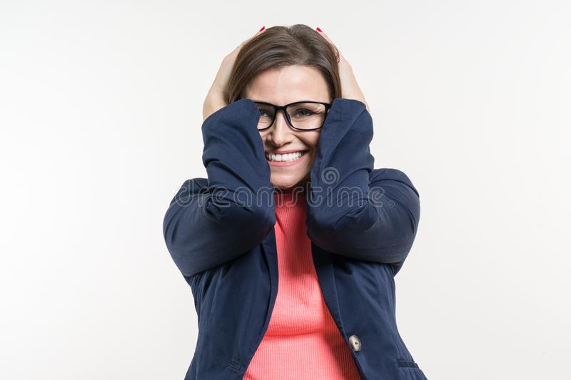 Portrait of very happy surprised adult business woman holding her head in amazement. White Background Studio.  stock photos