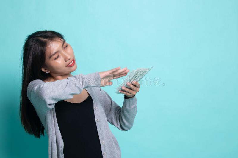 Portrait of very happy  young asian woman throwing out money banknotes royalty free stock photo