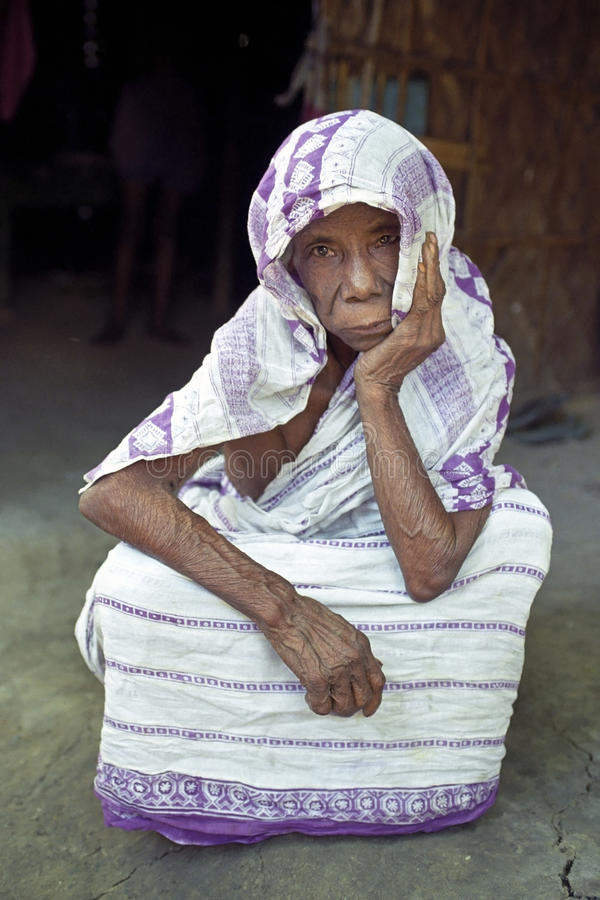 Portrait of very old woman, Bangladesh. Bangladesh, capital, city Dhaka: Portrait of a senior Bengali woman. The elderly lady is sitting in the typical Bengali stock photography