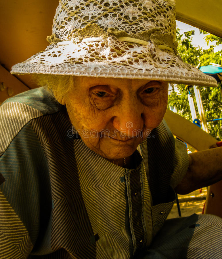 Portrait of very sad old woman. Wearing white hat, she is 89, photo took in Moscow, Russian royalty free stock image