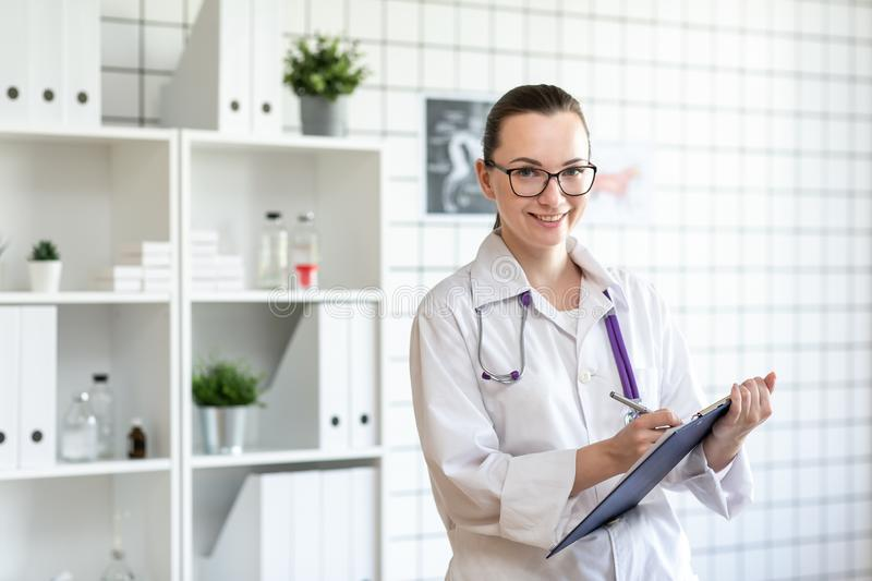 Portrait of a veterinarian doctor with a smile. Blurred background of veterinary clinic. Portrait of a veterinarian doctor with a smile. Blurred background of stock photography