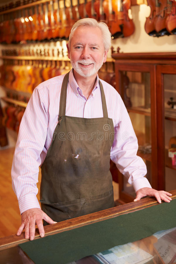 Portrait Of Violin Maker In Shop stock image