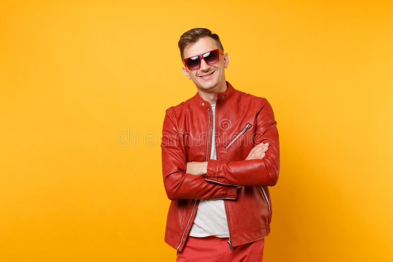 Portrait vogue cute handsome young man 25-30 years in red leather jacket, t-shirt sunglasses isolated on bright trending royalty free stock images