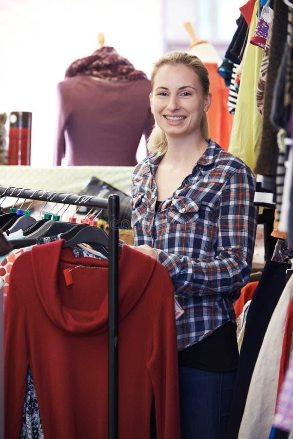 Portrait Of Volunteer Working In Charity Shop stock photo