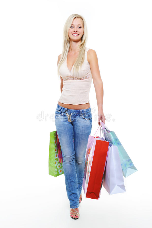 portrait of walking woman with shopping bags royalty free stock photos