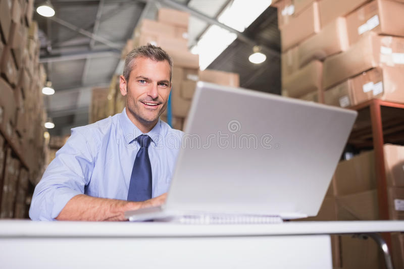Portrait of warehouse manager with laptop stock photo