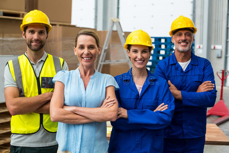 Portrait of warehouse manager and worker standing together with arms crossed royalty free stock photos