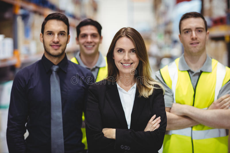 Portrait of warehouse manager and workers royalty free stock images