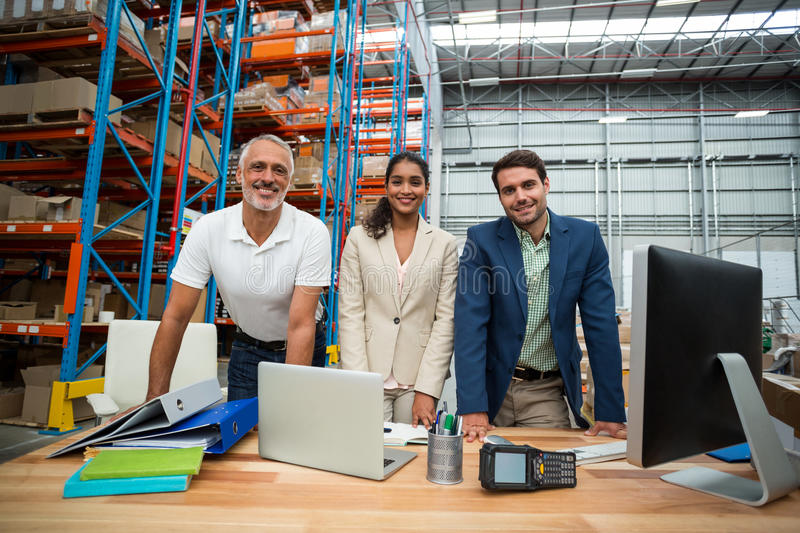 Portrait of warehouse managers and worker working together royalty free stock photography