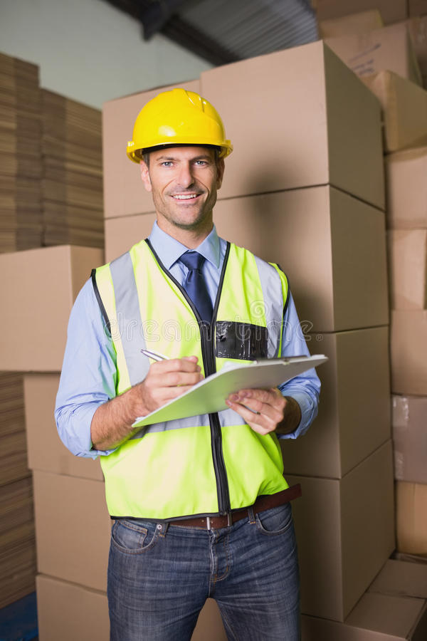 Portrait of warehouse worker with clipboard stock photos