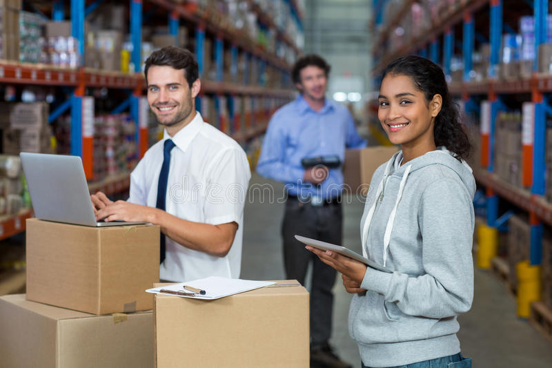 Portrait of warehouse worker standing together royalty free stock photography