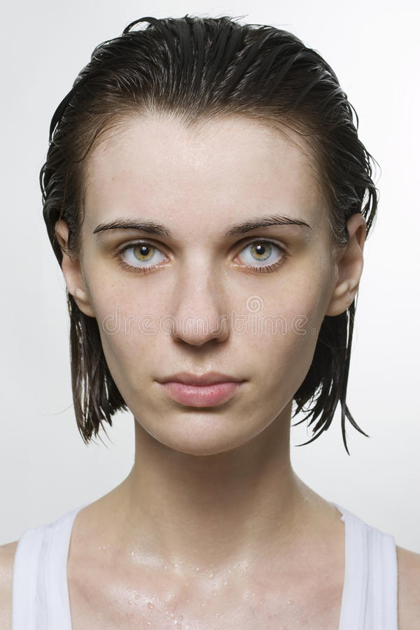 Portrait of wet woman. Portrait of the wet beautiful girl over white royalty free stock photos