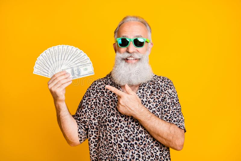 Portrait of white bearded funny old man in eyewear eyeglasses smile win lottery point at hold fan money credit deposit royalty free stock photos