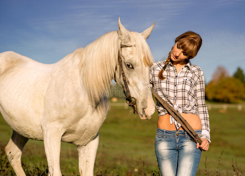 Portrait of a white horse and woman royalty free stock photos