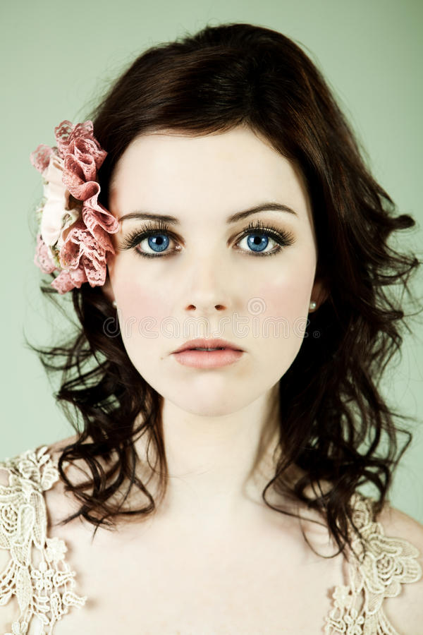 Portrait of a Wide-Eyed Young Woman royalty free stock images