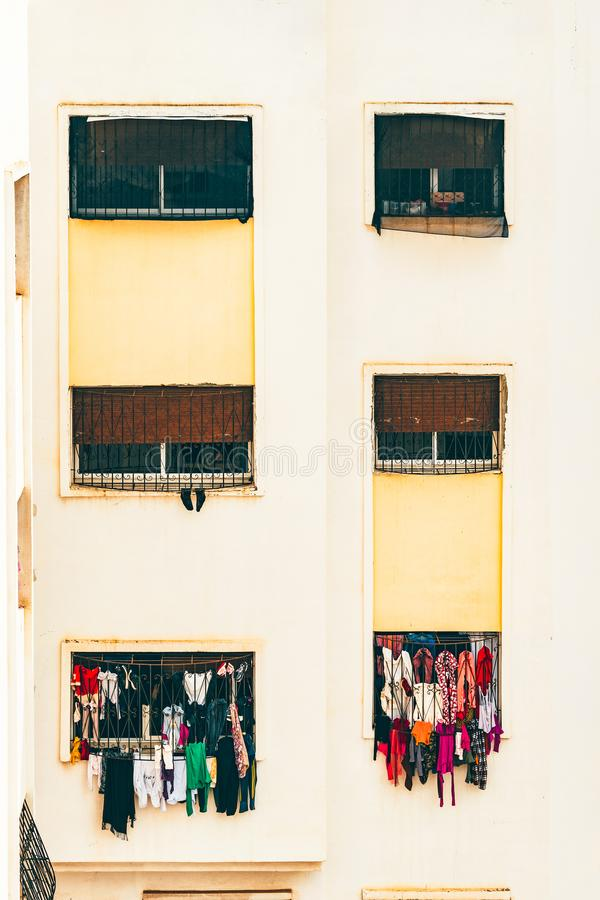 Portrait of Windows and clothes hanging from clothes line royalty free stock image