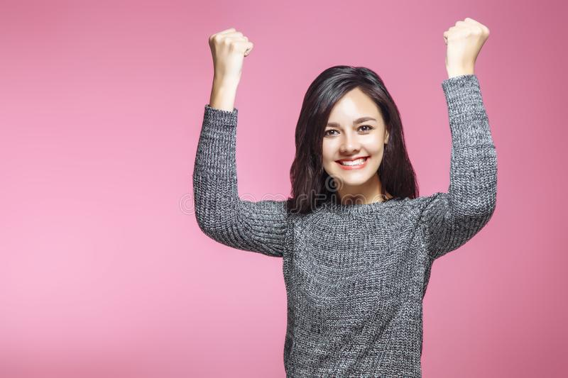 Portrait of winning successful young business woman, happy ecstatic celebrating being winner, on pink background. Positiv royalty free stock image