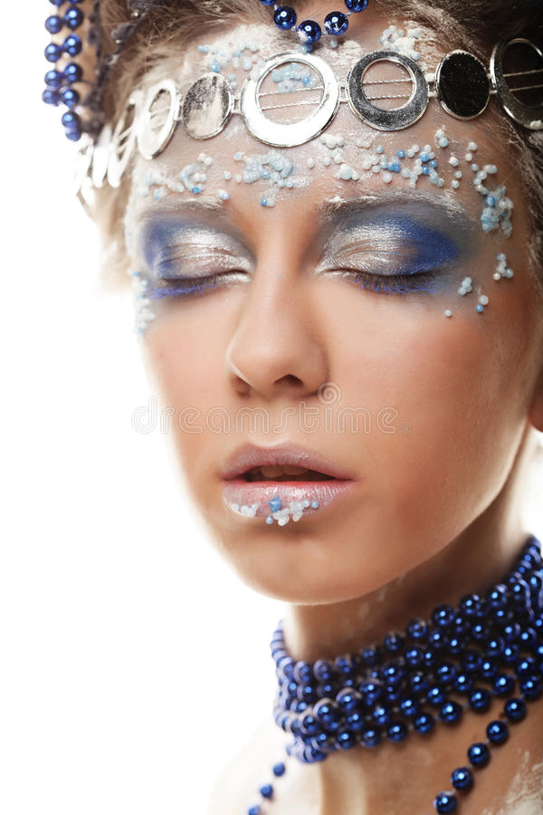 Portrait of winter queen with artistic make-up. Isolated on whit stock image