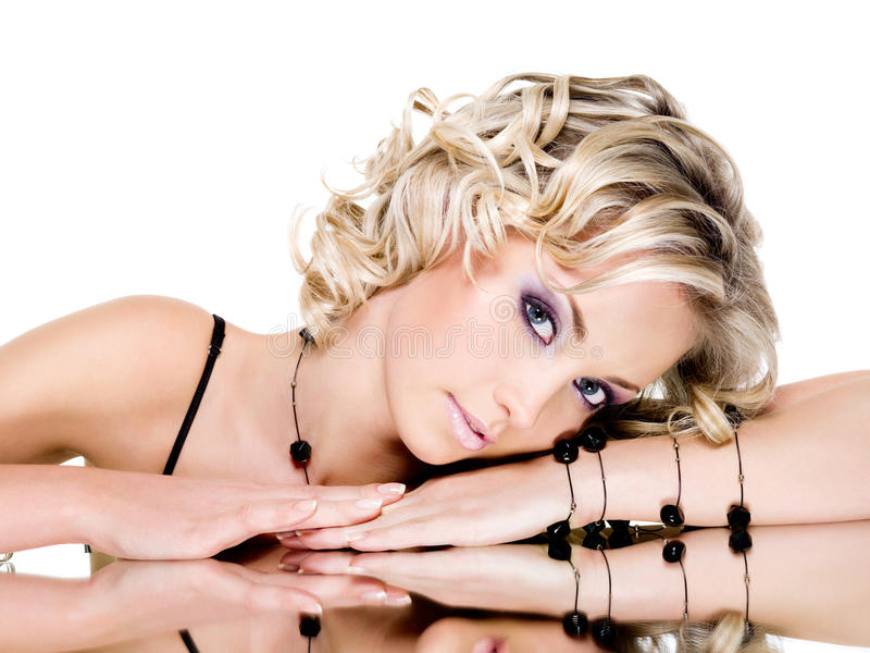 Portrait of woman. Portrait of blonde beautiful woman with mirror stock photo